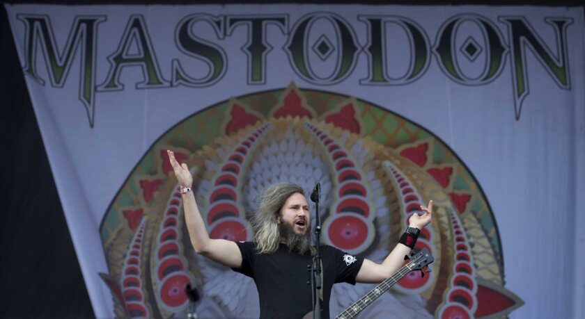 Troy Sanders of metal band Mastodon performs on stage during a music festival in June.