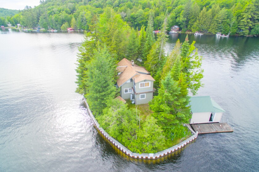 This quarter-acre island in Adirondack Park, N.Y., is anchored by a five-bedroom home and costs $524,000.