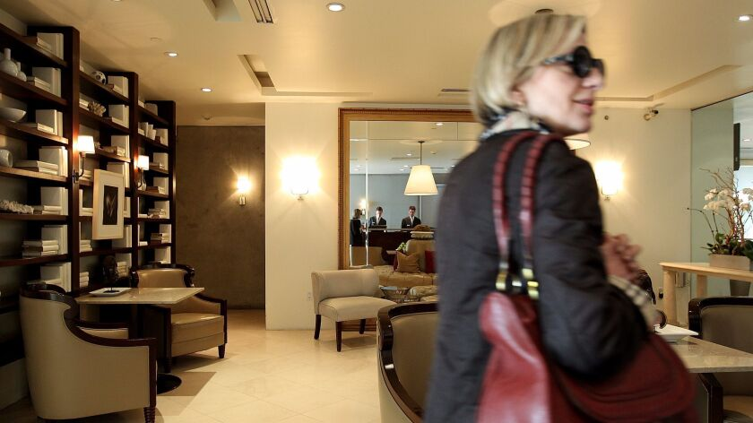 A guest in the lobby of the Luxe Hotel Rodeo Drive in 2012. The hotel will begin accepting Wechat Pay and Alipay in December.