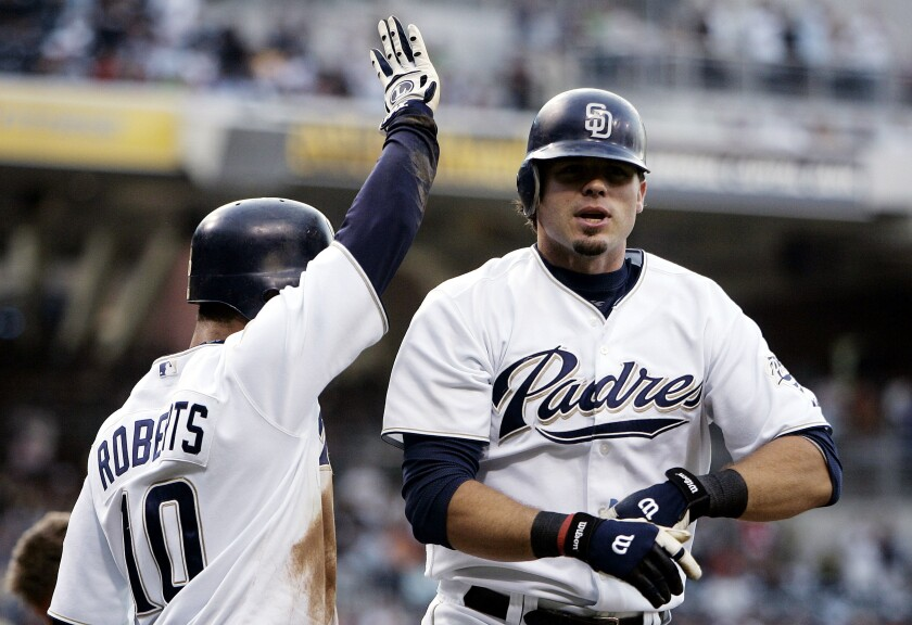 Ryan Klesko is congratulated by teammate Dave Roberts after Klesko's home run against Arizona on July 15, 2005 at Petco Park.