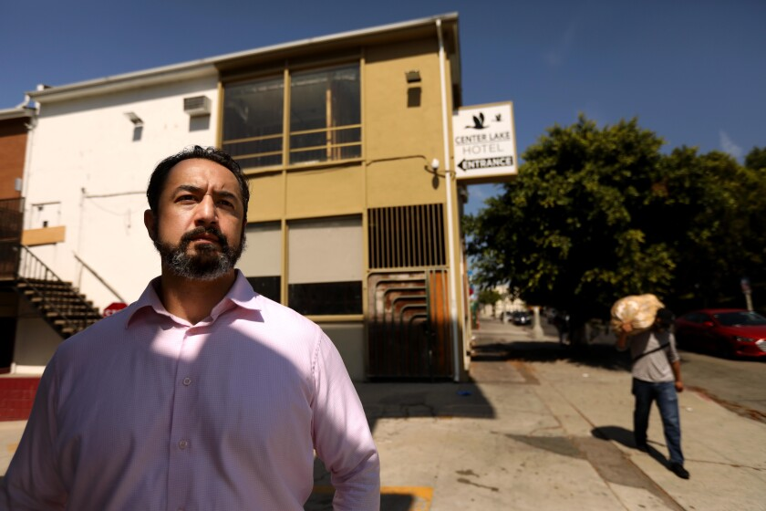 Marcos De La Toba, a former tenant at the Royal Park Motel, in front of the building at the center of numerous lawsuits.