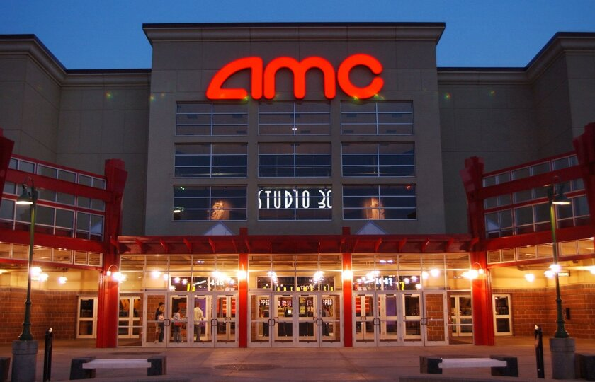FILE - In this May 11,2005 file photo, people enter AMC's Studio 30 theater in Olathe, Kan. AMC Theatres is buying European movie theater operator Odeon & UCI Cinemas Group in a deal valued at about 921 million pounds ($1.21 billion). AMC says, Tuesday, July 12, 2016,  that the transaction will mak