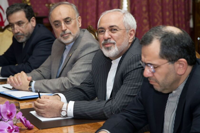 Iranian Foreign Minister Mohammad Javad Zarif, second from right, and the head of Iran's Atomic Energy Organization, Ali Akbar Salehia, second from left, sit at the negotiating table for nuclear talks in Lausanne, Switzerland. The talks are recessing until next week.