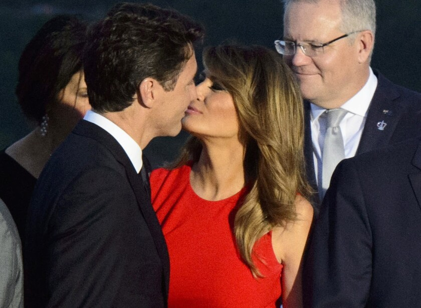 Prime Minister Justin Trudeau greets Melania Trump as she arrives for a family photo with President Donald Trump, during the G7 Summit in Biarritz, France, Sunday, Aug. 25, 2019.