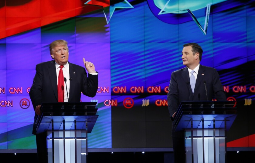 Ted Cruz, right, endorsed his former GOP primary rival Donald Trump on Friday.