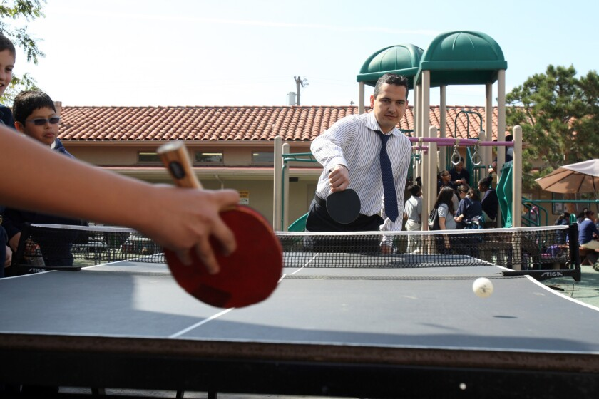 Principal John Terzi plays table tennis with students during recess at Magnolia Science Academy in Palms on March 3, 2014. The school is one of two Magnolia campuses that the L.A. Unified School District ordered shut down after an audit.