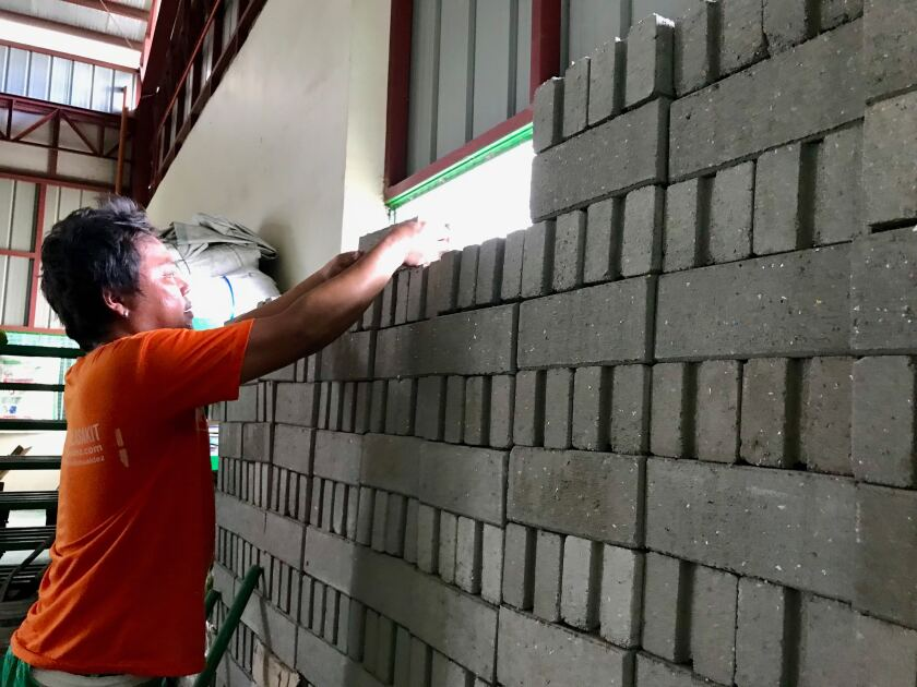 Bricks made partially from used plastic sachets are positioned at the Philippine Alliance for Recycling and Materials Sustainability recycling facility in Parañaque, a suburb of Manila.