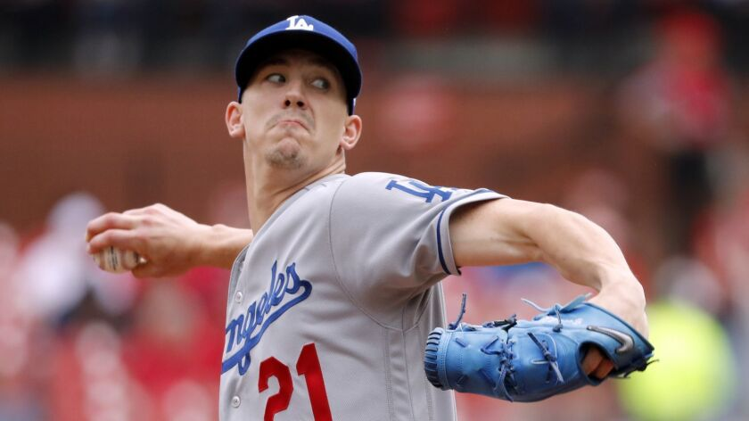 Los Angeles Dodgers starting pitcher Walker Buehler throws during the first inning of a baseball gam