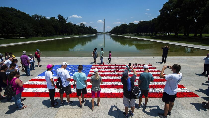 IMAGE DISTRIBUTED FOR THE LEGO GROUP - National Mall visitors help build a 16 ft wide by 31 ft long