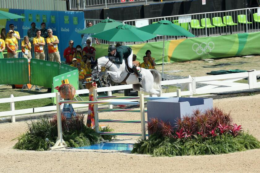Eduardo Menezes and Quintol competing at the Rio Olympics