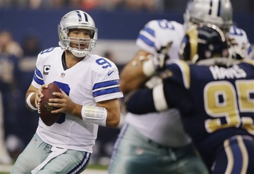 Dallas Cowboys quarterback Tony Romo (9) rolls back to pass against the St. Louis Rams during the first quarter of an NFL football game on Sunday, Sept. 22, 2013, in Arlington, Texas. (AP Photo/Tony Gutierrez)