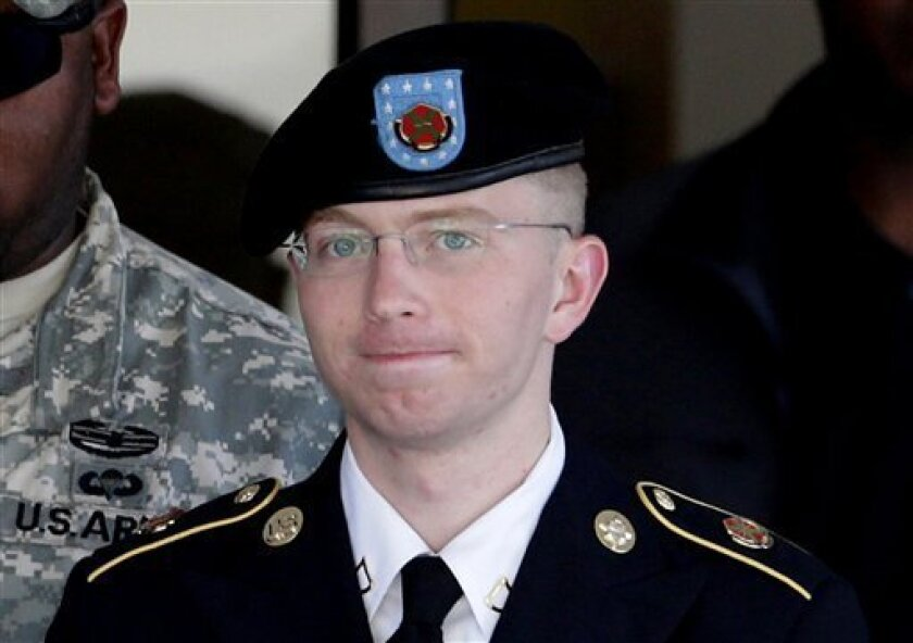 FILE - In this June 25, 2012 file photo, Army Pfc. Bradley Manning, right, is escorted out of a courthouse in Fort Meade, Md. The Army private charged in the largest leak of classified material in U.S. history says he sent the material to WikiLeaks to enlighten the public about American foreign and