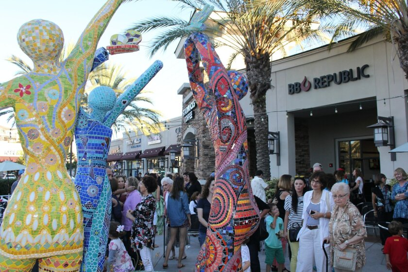 """The new sculpture, """"The Unbridled Spirit of a Child,"""" was unveiled at Torrey Hills Center. Photo by Karen Billing"""