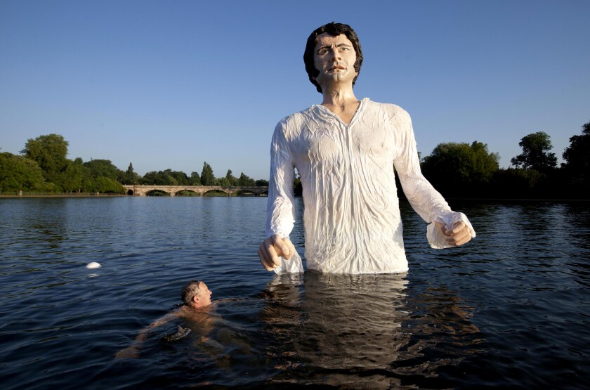 A statue of Colin Firth as Mr. Darcy rises above London's Serpentine Lake.