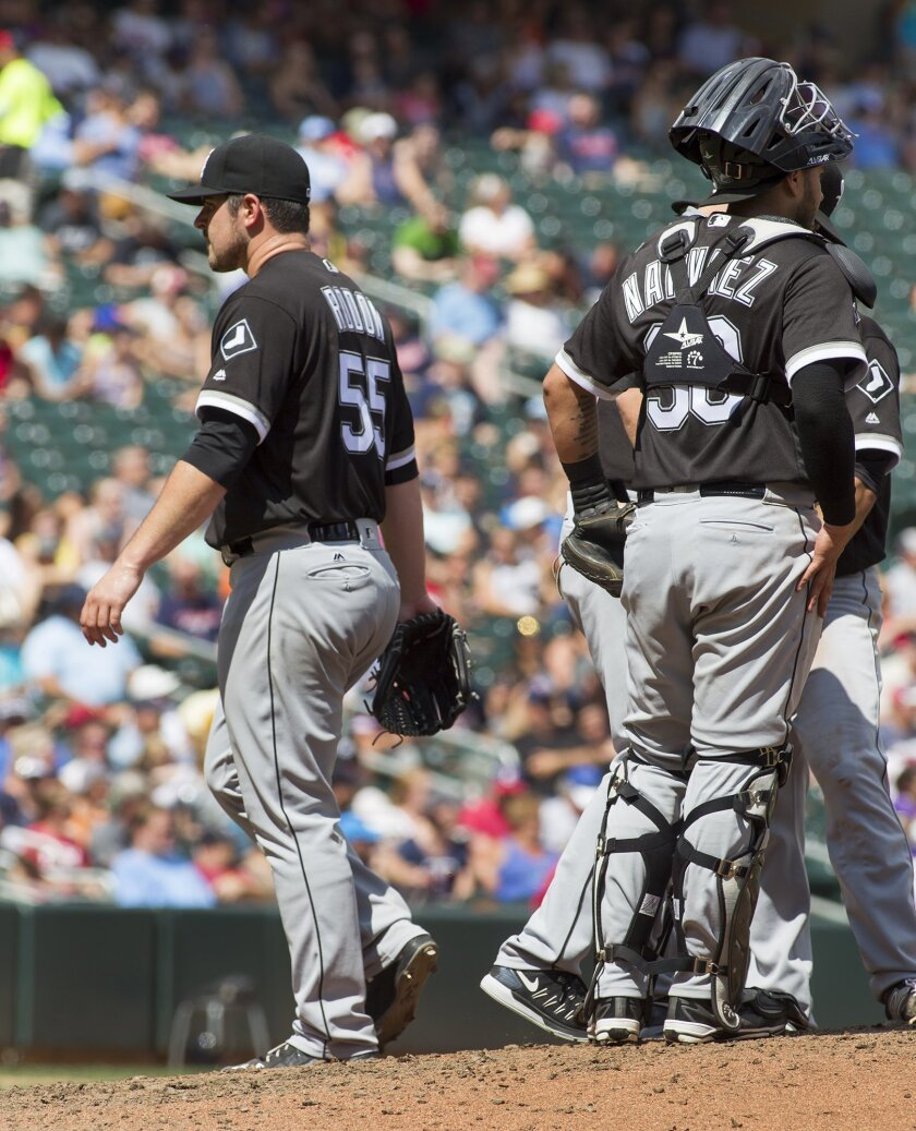 Chicago White Sox starting pitcher Carlos Rodon is removed during the seventh inning of a baseball game against the Minnesota Twins, Sunday, July 31, 2016, in Minneapolis. Rodon pitched 6 1/3 innings, giving up five runs on eight hits, as the Twins won 6-4. (AP Photo/Paul Battaglia)