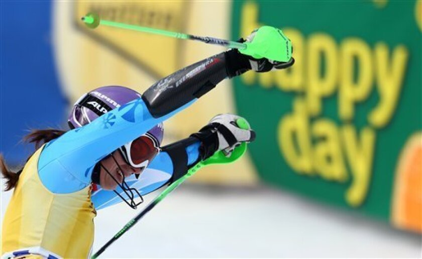 Tina Maze of Slovenia celebrates in the finish area after winning an alpine ski, women's World Cup slalom, in Ofterschwang , Germany, Sunday, March 10, 2013. (AP Photo/Giovanni Auletta)