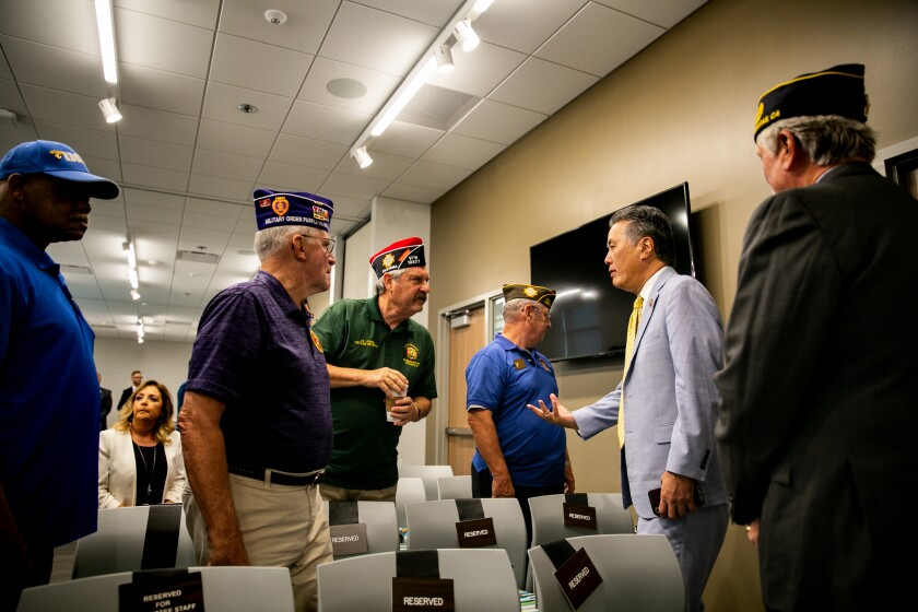 Congressman Mark Takano, the chairman of the House Committee on Veterans Affairs, speaks with veterans prior to a field hearing about veteran homelessness at the North County Coastal Military & Veterans Affairs Resource Center on August 22, 2019 in Oceanside, California.