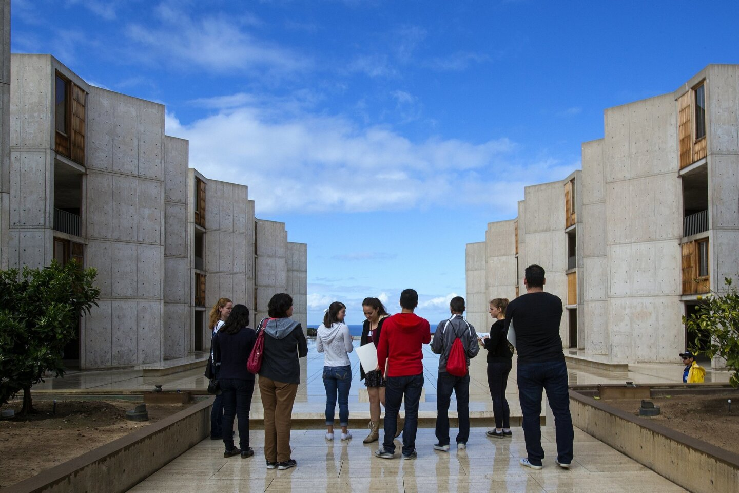 After being  broken into much smaller groups, these high school students stop at the Salk Institute courtyard to enjoy the view.