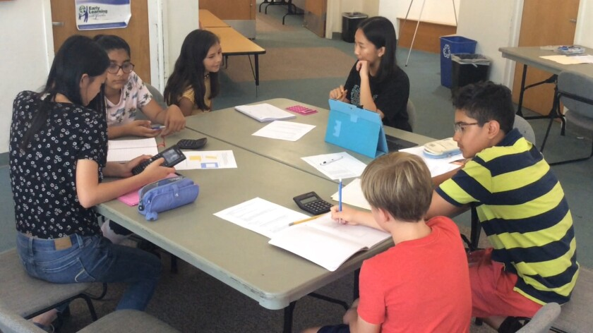 Summer math program instructors work with middle school students at the Rancho Peñasquitos Library.