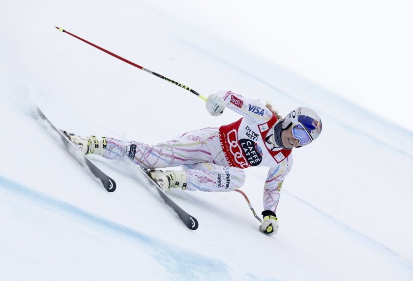 United States' Lindsey Vonn speeds down the slope during an Alpine ski, women's downhill training, in Crans Montana, Switzerland, Friday, Feb. 12, 2016. (AP Photo/Alessandro Trovati)