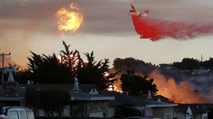 A massive fire following a pipeline explosion roars through a mostly residential neighborhood in San Bruno, Calif. on Sept. 9, 2010.