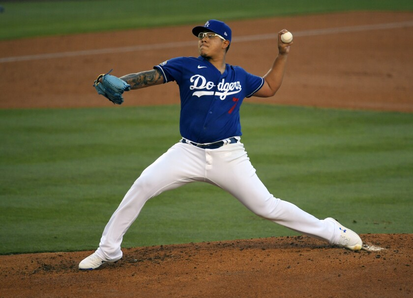 Dodgers starting pitcher Julio Urías throws during an intrasquad game in June 2020.