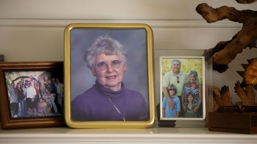 A photograph of Julie Shepherd on the mantel at Shepherd's home in West Covina.