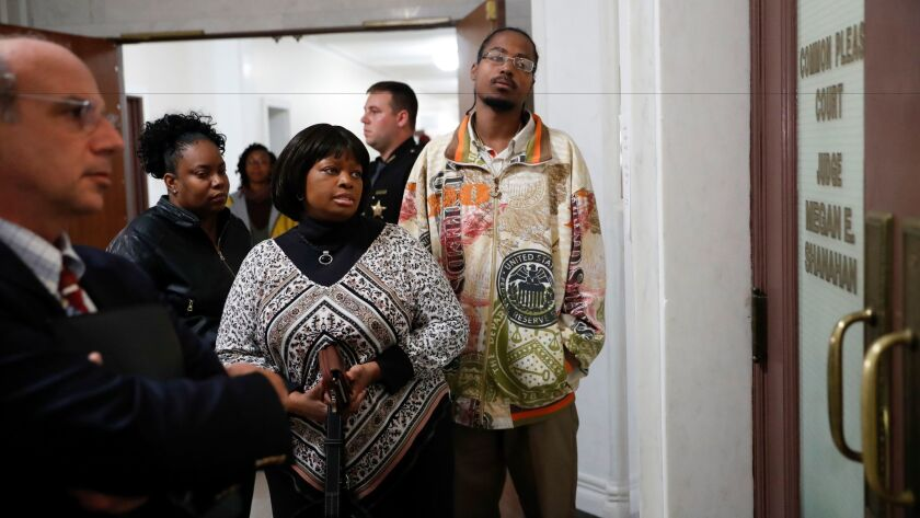 Terina Allen, Sam DuBose's sister, center left, waits outside of court on the third day of jury deliberations in the murder trial against Ray Tensing on Nov. 11 in Cincinnati.