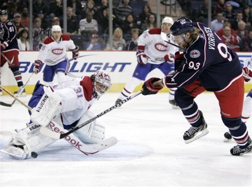 Montreal Canadiens goalie Carey Price, left, stops a shot by Columbus Blue Jackets' Jakub Voracek of the Czech Republic in the second period of an NHL hockey game in Columbus, Ohio, Tuesday, Nov. 2, 2010. (AP Photo/Paul Vernon)