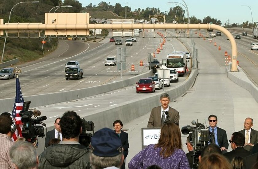 Caltrans Acting Director Malcolm Dougherty speaks during the grand opening ceremony of the last leg of the I-15 Express Lane Project at Del Lago Blvd., adjacent to Westfield North County Mall. In this view looking north. The group of vehicles in the distance are about to drive through the lane for the first time.