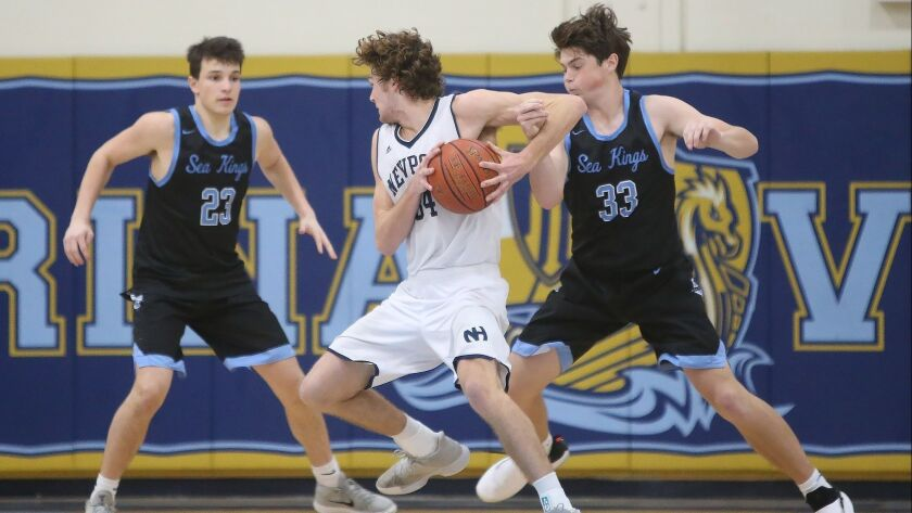Newport Harbor's Dayne Chalmers gets caught up in the arm of CdM's Ethan Garbers (33) during Surf Le