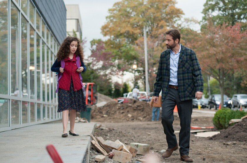 "Olivia Steele-Falconer, left, as Maria Fareri and David Duchovny as John Fareri in ""Louder Than Words."""