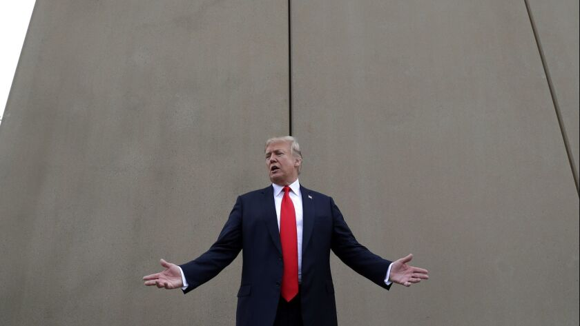 President Trump on a tour of border wall prototypes in San Diego last month.