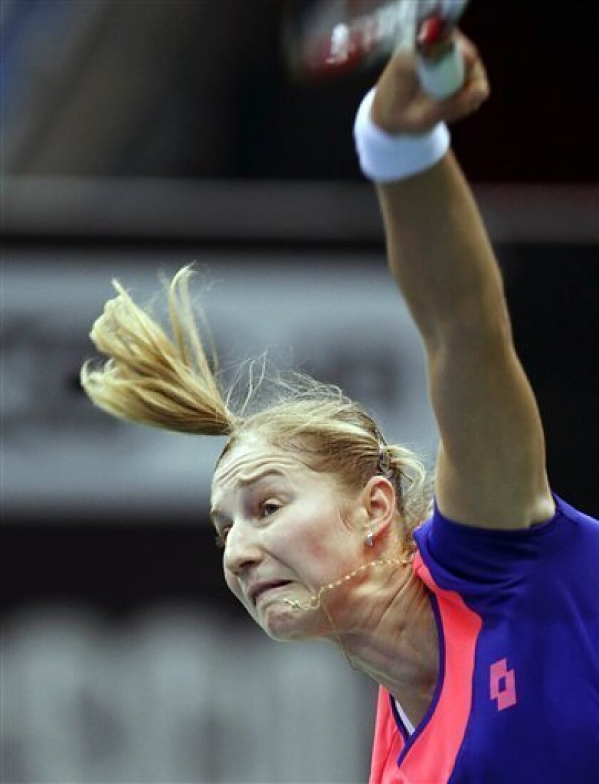 Russia's Ekaterina Makarova serves to Japan's Ayumi Morita during the Fed Cup match between Russia and Japan in Moscow, Russia, Saturday, Feb. 9, 2013. (AP Photo/Misha Japaridze)