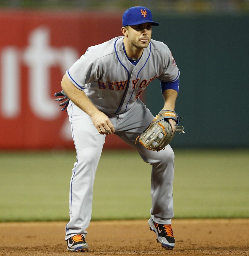 FILE - In this Wednesday, April 20, 2016 file photo, New York Mets' David Wright is seen in action during a baseball game against the Philadelphia Phillies in Philadelphia. David Wright avoided the disabled list Tuesday, May 31, 2016 at least for now. Hoping their ailing third baseman can return in