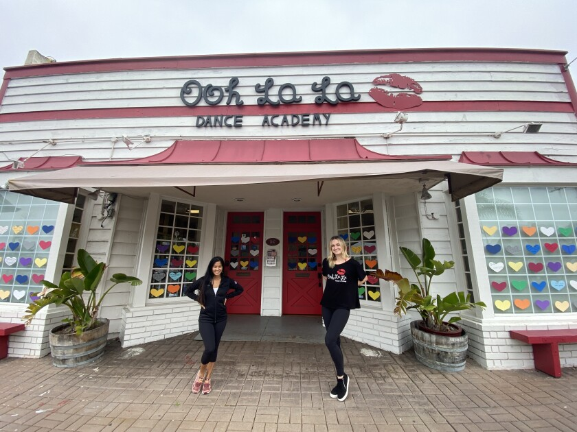 Ooh La La Dance Academy owner Susie Grafte (left) and teacher Brittany Jagoe stand outside the studio in La Jolla, which is currently shut because of mandated coronavirus-related closures. The business also has a location in Pacific Beach.