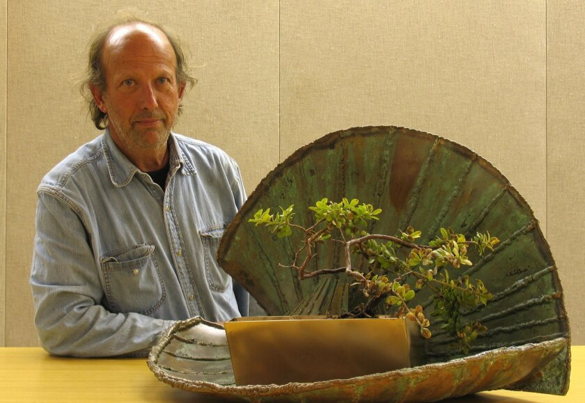 Danny Salzhandler with one of his sculptures.