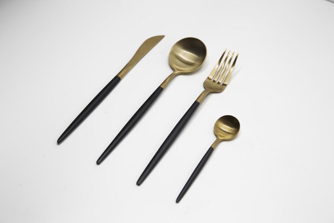 Gold and matte black four-piece set of dishwasher safe utensils