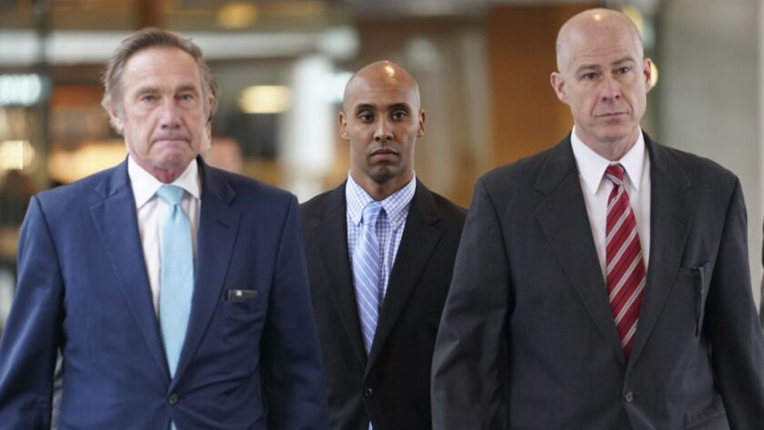 Former Minneapolis Police Officer Mohamed Noor heads into the Hennepin County Government Center in Minneapolis to hear the verdict in his trial Tuesday.