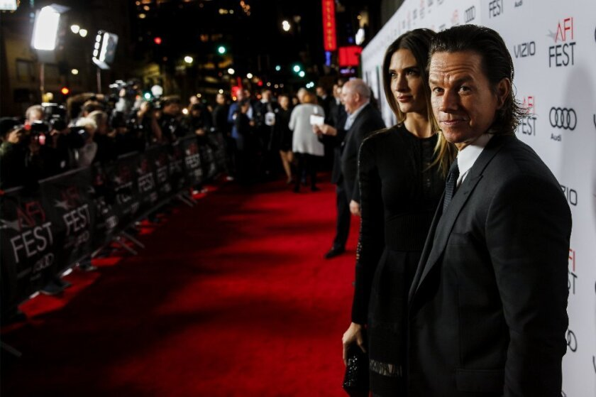 "Mark Wahlberg and his wife, Rhea Durham, attend the AFI Fest premiere of ""Patriots Day."""