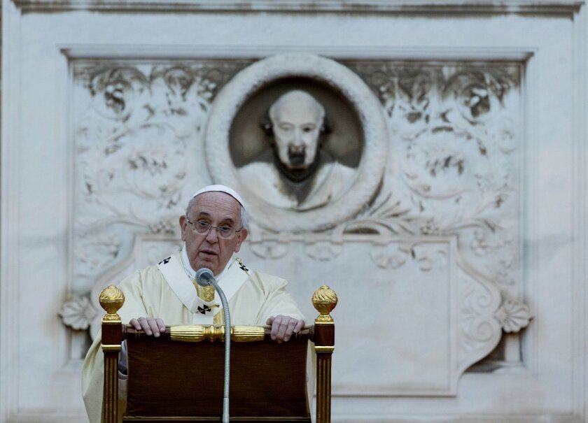 Pope Francis celebrates a mass at Rome's Verano cemetery, on the occasion of All Saints Day festivity in Rome, Saturday, Nov. 1, 2014. (AP Photo/Alessandra Tarantino)
