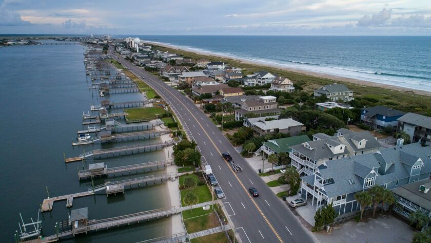 The streets in Wrightsville Beach, N.C., were nearly empty two days before Hurricane Florence came ashore.
