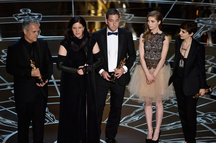 """Producer Dirk Wilutzky, director Laura Poitras, journalist Glenn Greenwald, Lindsay Mills and producer Mathilde Bonnefoy accept the documentary feature Oscar on Sunday for """"CitizenFour"""" onstage."""