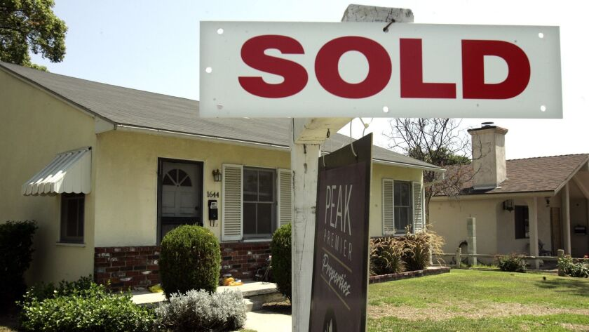 """Photo of a """"sold"""" sign outside a home."""