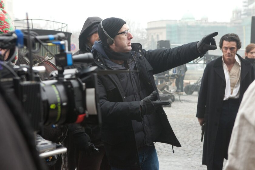 """Director James McTeigue discusses a scene with star Luke Evans on the set of gothic thriller """"The Raven."""" Larry Horricks/ © 2011 Amontillado Productions, LLC."""