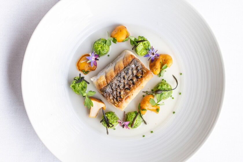 Baja seabass with seasonal vegetables, one of the dishes on chef de cuisine Sean McCart's menu at Mille Fleurs restaurant in Rancho Santa Fe.