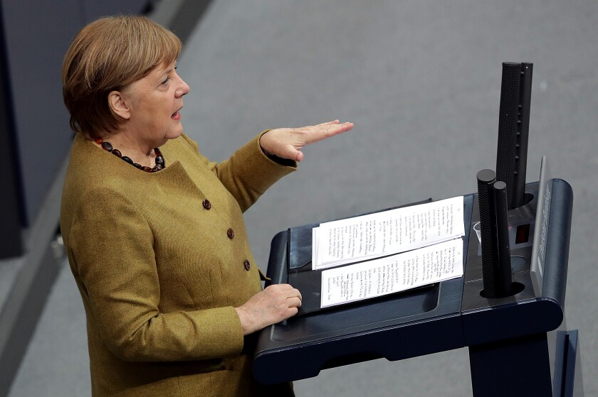 German Chancellor Angela Merkel delivers a speech during a meeting of the German federal parliament, Bundestag, at the Reichstag building in Berlin, Germany, Thursday, Feb. 11, 2021. (AP Photo/Michael Sohn)