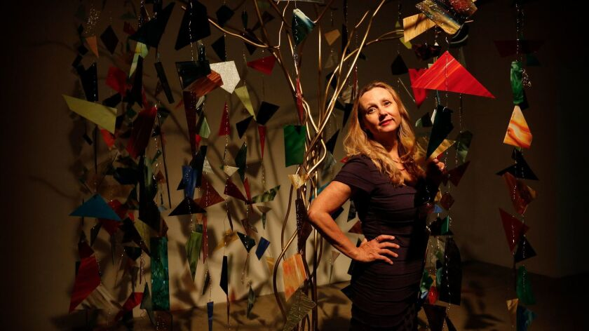 "Artist Marnie Weber stands in her installation ""Chapel of the Moon"" at Gavlak gallery in Hollywood."