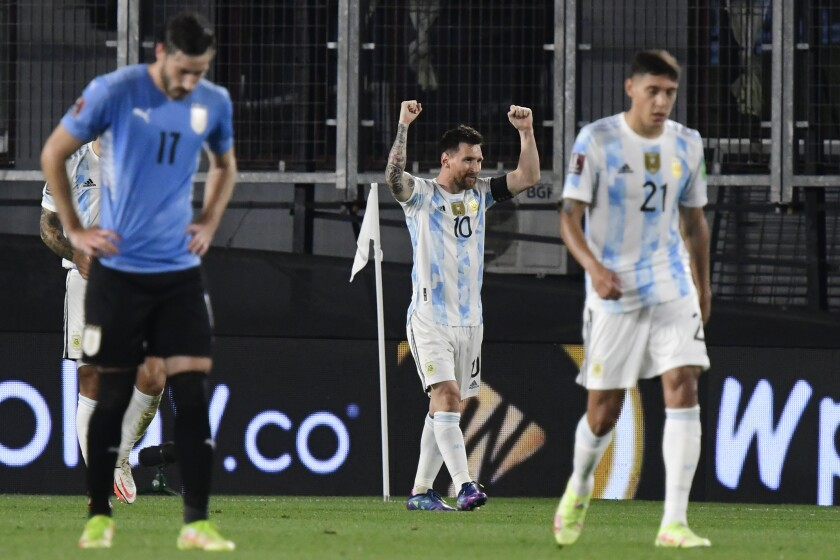Argentina's Lionel Messi celebrates scoring the opening goal against Uruguay during a qualifying soccer match for the FIFA World Cup Qatar 2022 in Buenos Aires, Argentina, Sunday, Oct. 10, 2021. (AP Photo/Gustavo Garello)