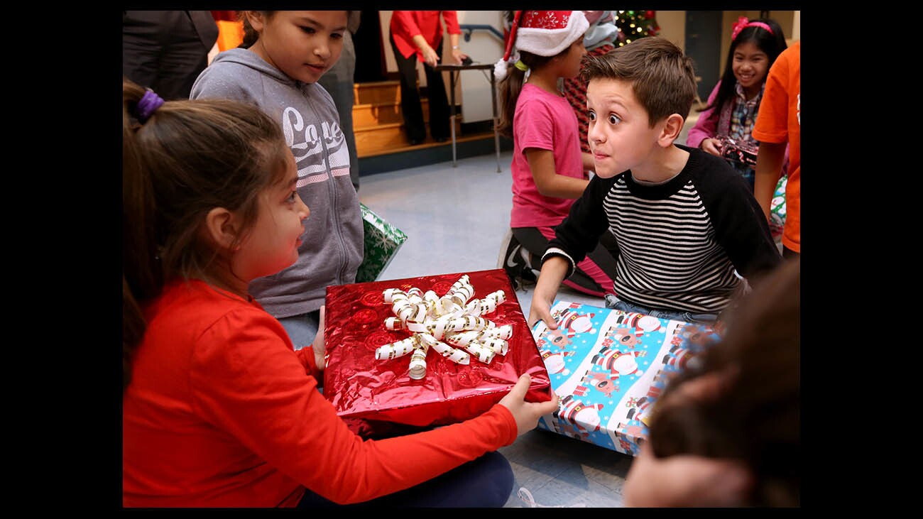 Photo Gallery: Cerritos Elementary school students receive gifts from Dignity Health Glendale Memorial Hospital and Health Center